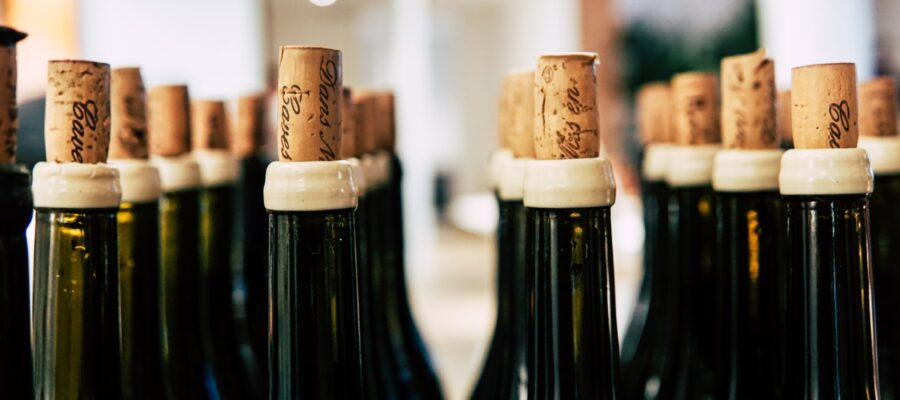 Close up photo of wine bottles with cork
